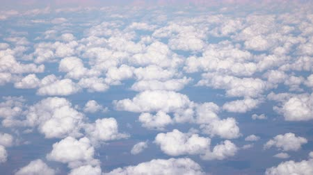 puffy cloud : AERIAL: Looking from airplane on Great Victoria Desert and small white puffy clouds. View of vast interesting landscape scenery of arid, deserted area with sandhills and grassland plains Stock Footage