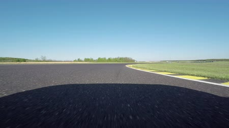 excesso de velocidade : Sarvar, Hungary, April 15, 2016: FPV LOW ANGLE VIEW: Racecar driving fast on the race track on professional racing circuit. Personal car driving the practice qualifying lap on trackday at the ring. Vídeos