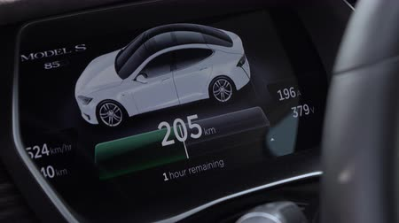 tesla model s : LJUBLJANA, SLOVENIA - JULY 10 2016: Innovative instrument technology in Tesla Model S. display showing charging batteries status, current supplied, voltage and remaining time until fully charged Stock Footage