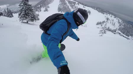 smashing : CLOSE UP: Extreme snowboarder riding fresh powder snow in beautiful snowy mountain and falls down badly. Freeride snowboarder snowboards and crashes in perfect powder snow in mountain ski resort Stock Footage