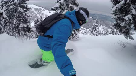 snowboard : CLOSE UP: Extreme snowboarder riding fresh powder snow backcountry on snowy mountain and falls down badly. Freeride snowboarder snowboarding and crashing in perfect powder snow in mountain ski resort