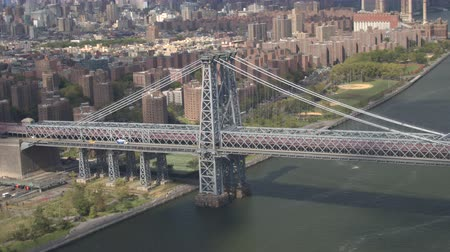 multiple lane : AERIAL CLOSE UP: Flying above famous Williamsburg Bridge over East River. Free tool multilane highway with cars and semi-trucks traveling from Brooklyn borough to Manhattan downtown New York City Stock Footage