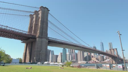 ikonik : NEW YORK, USA - SEPTEMBER 23: Iconic view of Brooklyn bridge with high contemporary skyscrapers of downtown Manhattan in background. Brooklyn bridge connecting Brooklyn and Manhattan in New York City