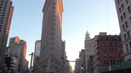 ave : NEW YORK, USA - SEPTEMBER 23rd 2016: Driving in doble decker touristic bus along busy streets of NYC towards iconic Flatiron Building. Office buildings and residential tower blocks on sunny evening