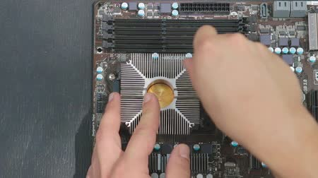 chipset : Service man removing cooling system from motherboard. Stock Footage