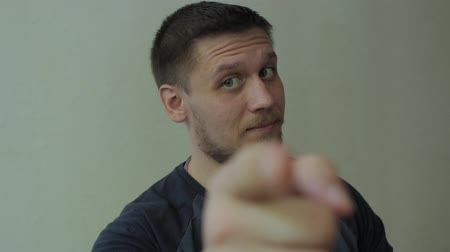 зрелом возрасте : Man pointing at the camera and showing his thumb up.