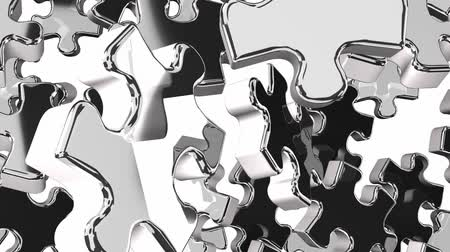 кусок : Silver Jigsaw Puzzle On White Background Стоковые видеозаписи