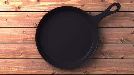 кухонная посуда : Cast iron skillet on wood background