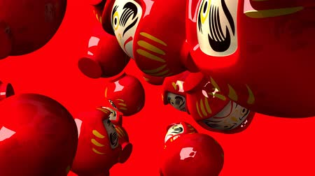 zvyk : Red daruma dolls on red background