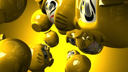 кукла : Yellow daruma dolls on yellow background Стоковые видеозаписи