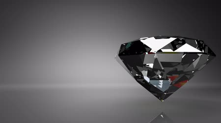 Diamond on black text space.Loop able 3D render Animation.