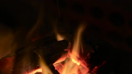 helyek : Close-up of burning logs in a fireplace