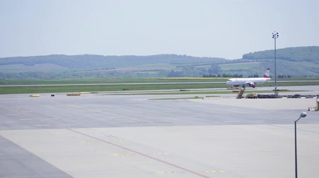 takeoff area : VIENNA, AUSTRIA-APRIL 30th 2016: Plane arriving at terminal area of Vienna International Airport.