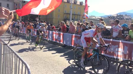 seçkinler : Innsbruck, Tyrol  Austria - September 30th 2018: World's best road cyclists compete in road races at the 2018 UCI Road World Championships. Men Elite Road Race Finals. Peloton passing the crowd.