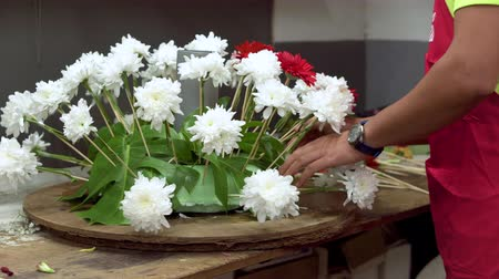 Florist at work. Male florist creating beautiful bouquet at flower shop. Close up . Dostupné videozáznamy