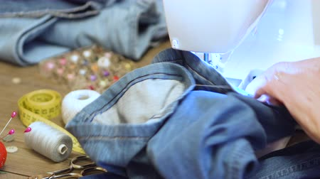 çivit : Sewing denim jeans with sewing machine. Repair jeans by sewing machine.