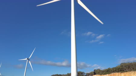 natural resource : Wind energy turbines on blue sky background, sustainable ecological energy production.