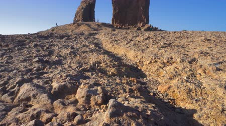 kanarya : Roque Nublo mountain in Gran Canaria, Canary Islands on a blue sunny day. Cinematic camera movement.