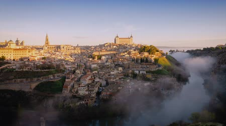 iberian : 4K timelapse video at sunrise at Toledo, Spain. Old town cityscape with mist clouds moving over the river.