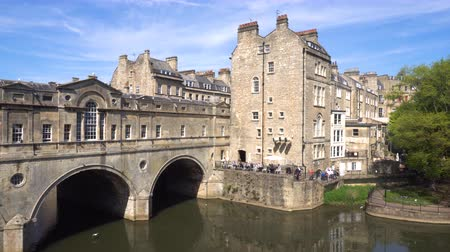 arch bridges : Bath, England. River Avon shot with Pulteney bridge, and the city of Baths skyline