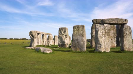earthworks : pan shot of Stonehenge on a beautiful sunny day Stock Footage