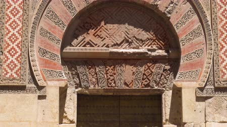 mór : Tilt shot of door and facade of the Mosque of Cordoba, Andalucia, Spain. Stock mozgókép