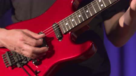 acoustical : Musician playing red electric guitar. Stock Footage