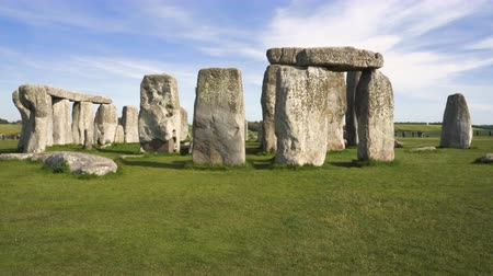 earthworks : Tilt shot of famous prehistoric monument Stonehenge on a beautiful sunny day.