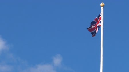 manor : British flag with copy space in the wind and the blue sky. On a nice sunny day. Stock Footage
