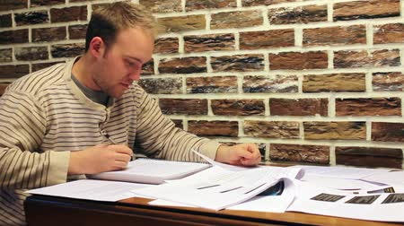 prova : Male College Student Studying Push Papers Stock Footage