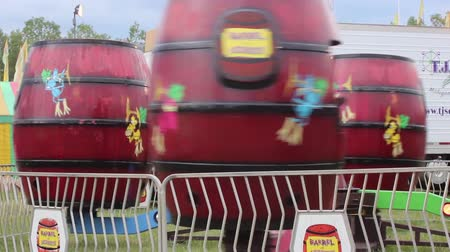 perili : Carnival spinning barrells ride close up