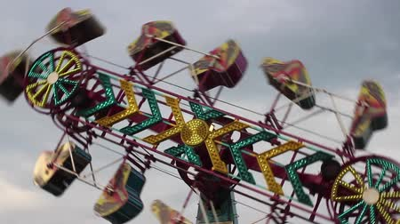engedmény : Zipper ride at the Carnival rotatingspinning around