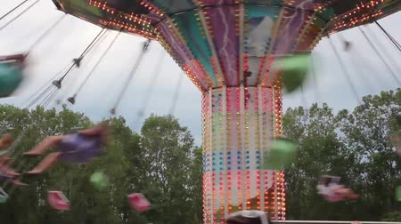 engedmény : Closer View of the Swings at the Carnival
