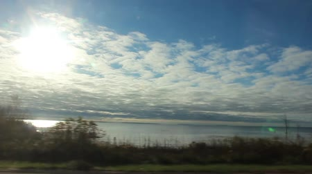Driving Footage Side Window Lake Sun Clouds Vídeos