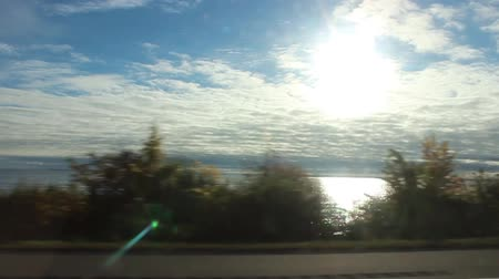Driving Footage Side Window Lake and Sun with Bump Vídeos