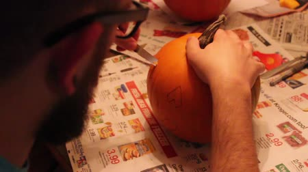 Man Carving Small Pumpkin