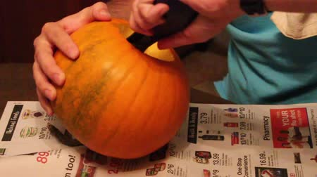 Man Getting Ready to Gut Pumpkin