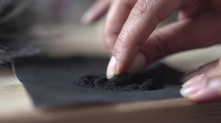 малая глубина резкости : An Artist Sharpening black Coal Pencil or black block chunk