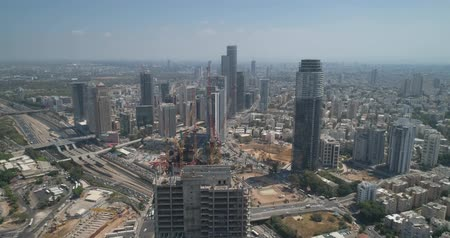緊急性 : Aerial View Of Tel Aviv Skyline At Day.  Drone over high buildings daytime 動画素材