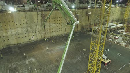 mikser : Pouring cement at construction site at night. Stok Video