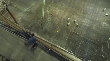 reinforced concrete : Pouring cement at construction site at night. Stock Footage