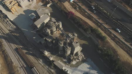 pedreira : Aerial Drone over cement factory. Trucks loading and pouring sand. Building Industrial footage Stock Footage
