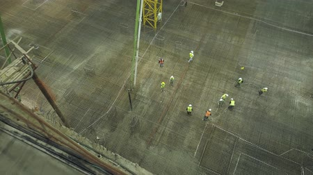 reinforced concrete : Pouring cement at construction site at night. workers Pouring cement