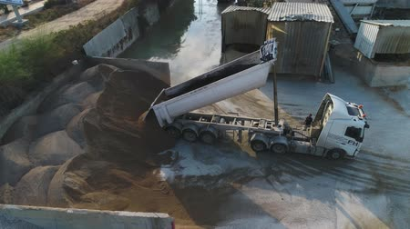 hormigonera : Aerial Drone over cement factory. Trucks loading and pouring sand. Building Industrial footage Archivo de Video