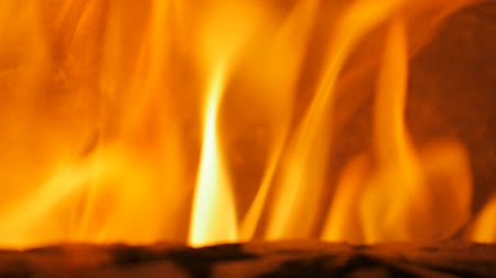 aglow : Fire in fireplace or stove - close up of burning wood in pizza oven, slow mo