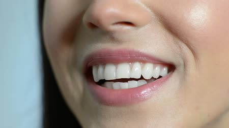 boca : Close Up Of Beautiful Womans Mouth With Perfect Teeth As She Speaks