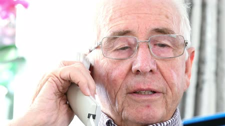nuisance : Senior Man Giving Credit Card Details On The Phone