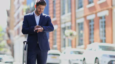 london cab : Businessman Using Mobile Phone App To Order Taxi Stock Footage