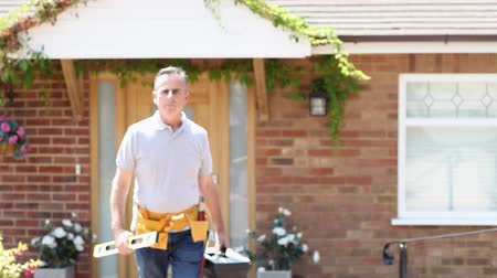 fidedigno : Portrait Of Mature Builder With Tools Outside House