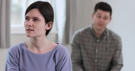 pleading : Couple With Relationship Problems Having Argument At Home Stock Footage